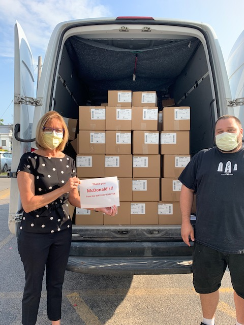 Two people with boxes of masks